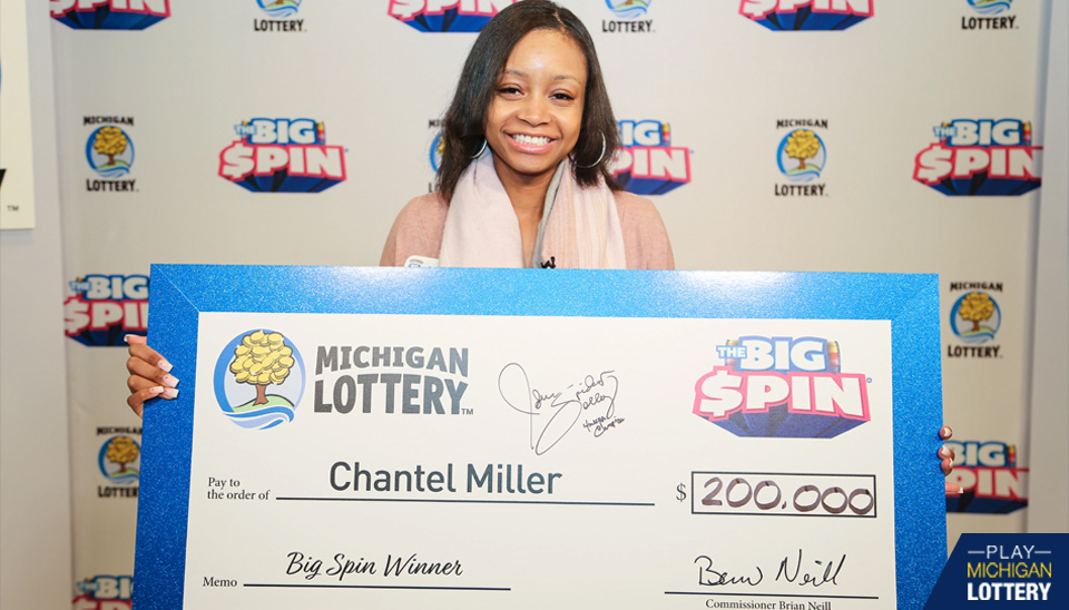 Chantel Miller holding big check after winning on The Big Spin Show