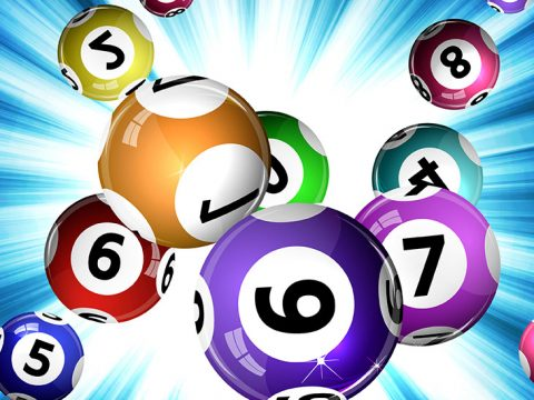 Colourful powerball on blue background